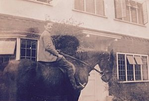 "This family photograph is captioned ""Alan outside ""Friston""."
