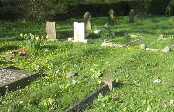 Seen across the wildflower-strewn churchyard of St Barnabas, Henry and Kenneth's graves are the two nearest headstones. Ken's is the white one to the right, tended as an official war grave every year by the Commonwealth War Graves Commission.