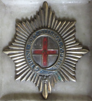 The Coldstream badge set in the altar pavement in the Cubitt Chapel, St Barnabas