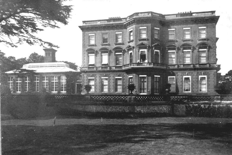 Denbies Mansion in 1912 from the south. On the left, a magnificent conservatory starts the quarter-mile run of glasshouses (Ranmore Archive)