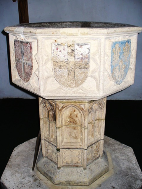 The medieval font at Bramley (originally from a church in Norwich) where the older Baker children were christened, Colin
