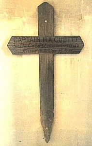 Harry's battlefield grave marker, subsequently replaced by a larger wooden cross and later a headstone. Both crosses now hang in the Cubitt Chapel at St Barnabas (Brian Belton)