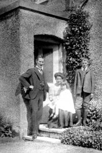 Sarah Jane Boxall with her husband and children outside Dairy Cottage, about 1912