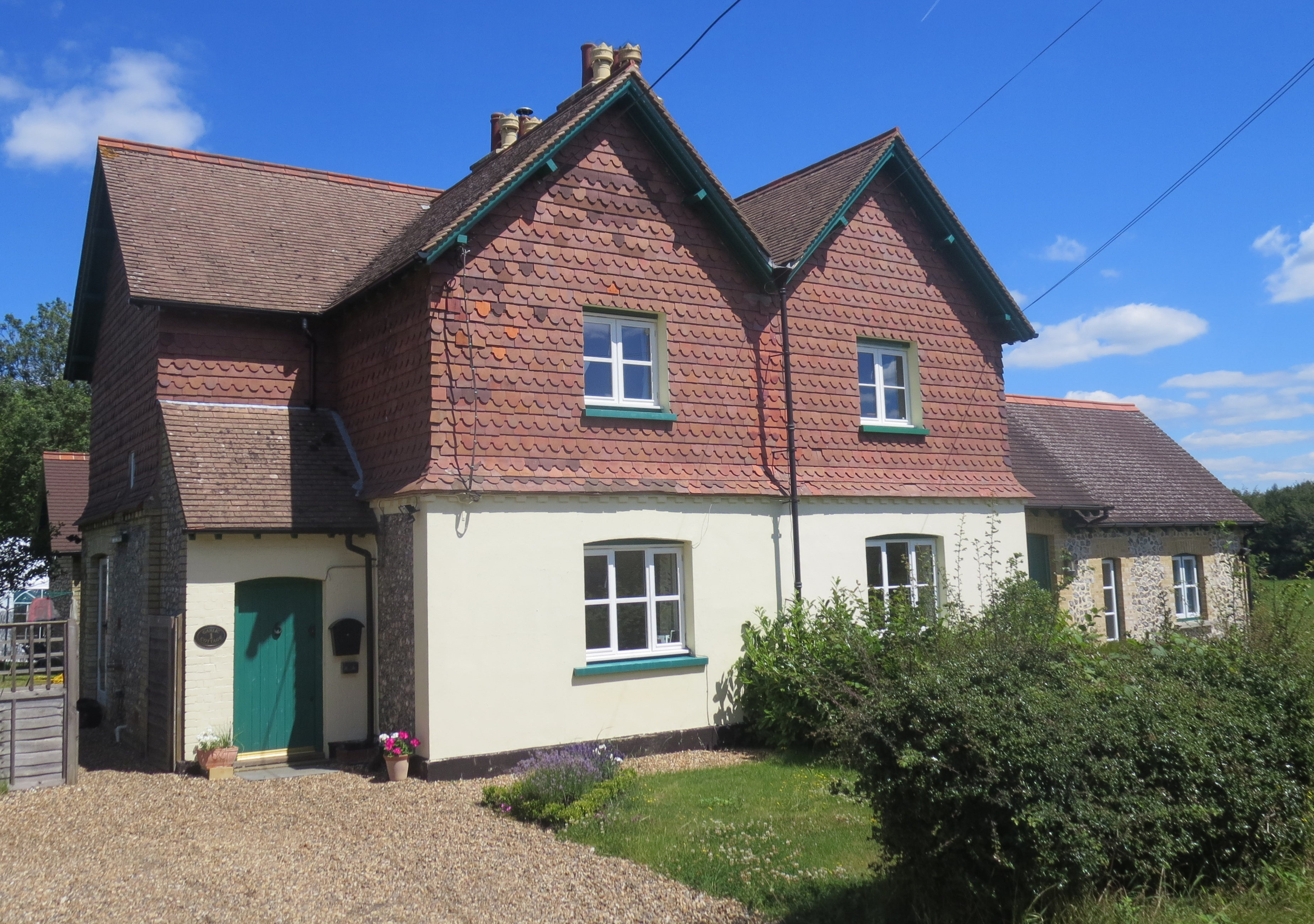Garlic Cottages today No 1, on the left,usually seems to have been the Estate blacksmith's house. In 1891 the right hand cottage was the home of Annie Adelaide and James (No 2)