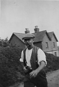 Fred Hodgkinson outside Garlic Cottages, Ranmore Archive