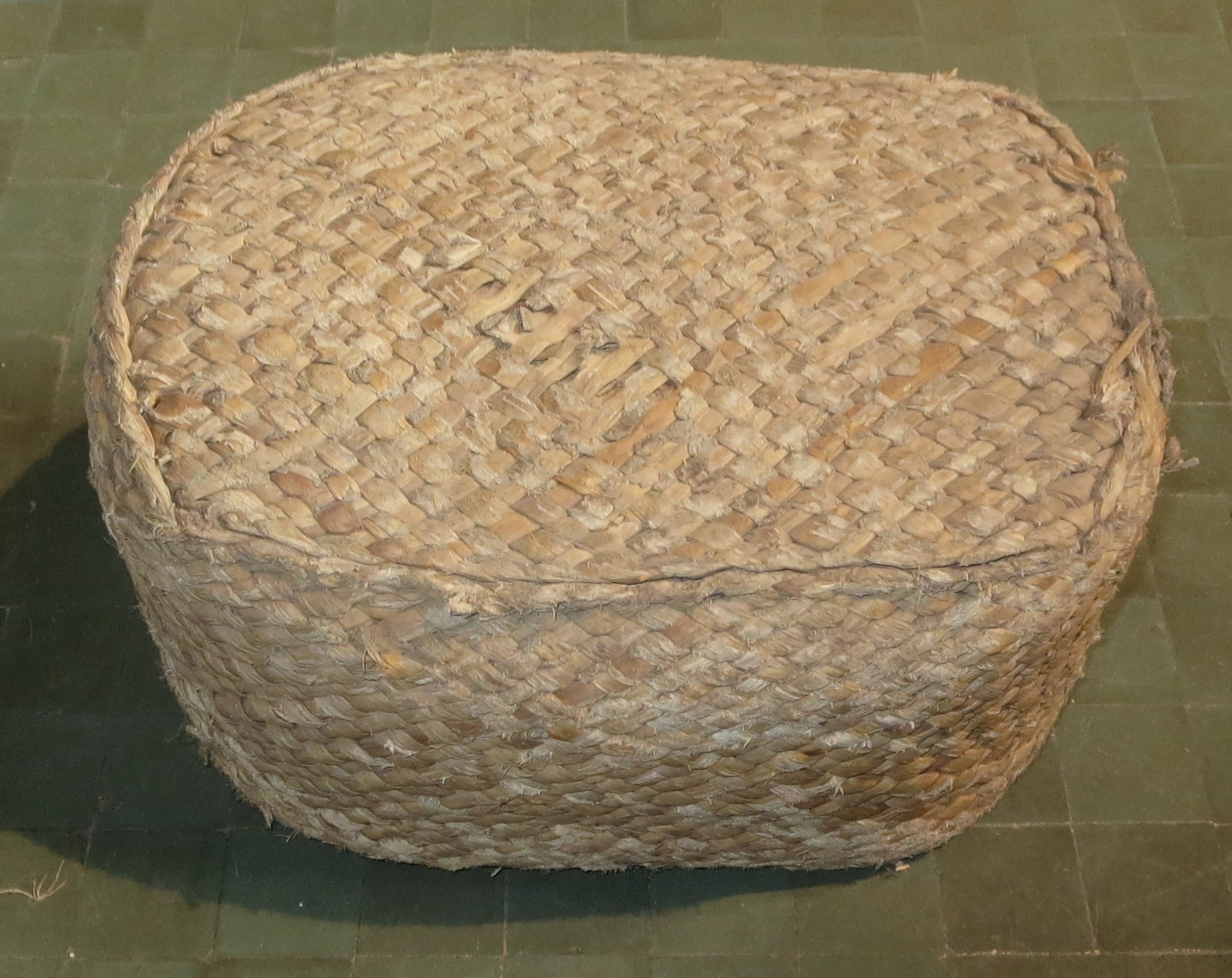 A rush hassock. probably one of those given by Henry Cubitt,