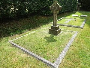 The grave in St Barnabas Churchyard of Mary Agnes and Canon Chichester (F 7 and 8). The grave behind, with the horizontal cross, is that of Mary's sister Adelaide and her