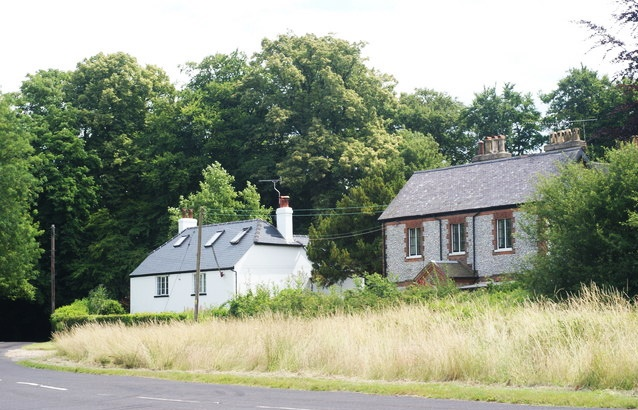 The white-painted West Cottage, first home of Edward George Baker, is also the first house reached as the road from Dorking climbs the hill. Geograph -