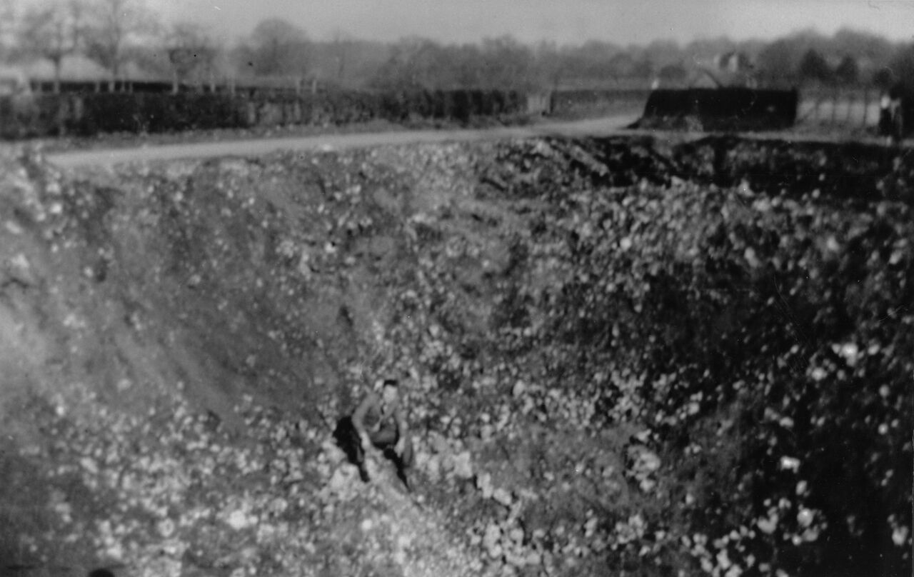 A large bomb crater on Ranmore, near the dairy yard, Dorking