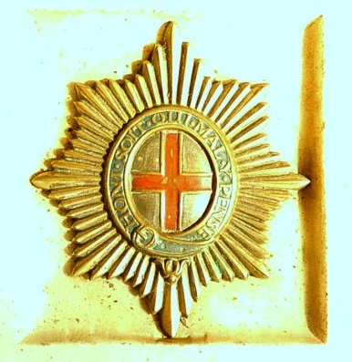 The badge of the Coldstream Guards inset in the pavement of the Cubitt Chapel,