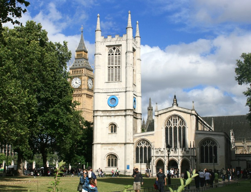 St Margaret's Westminster, the venue of many society weddings. Big Ben, clocktower of the Palace of Westminster is in the left hand background (Geograph, copyright